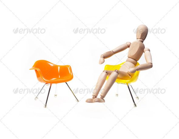 wood mannekin sitting over white - Stock Photo - Images
