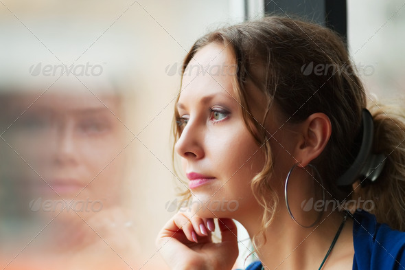 Beautiful Woman Looking Through A Window - Stock Photo - Images