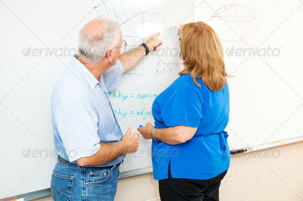 Adult Education - Teaching Math - Stock Photo - Images