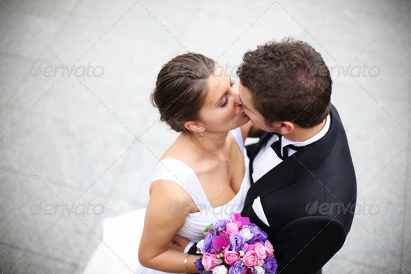 PhotoDune Young married couple kiss 1740891
