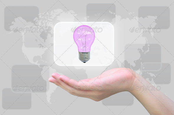 light bulb in women hand - Stock Photo - Images
