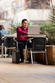 Hispanic Businessman - Telecommuting from Internet Cafe - PhotoDune Item for Sale