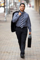 Hispanic Businessman - Walking Downtown With Briefcase - PhotoDune Item for Sale