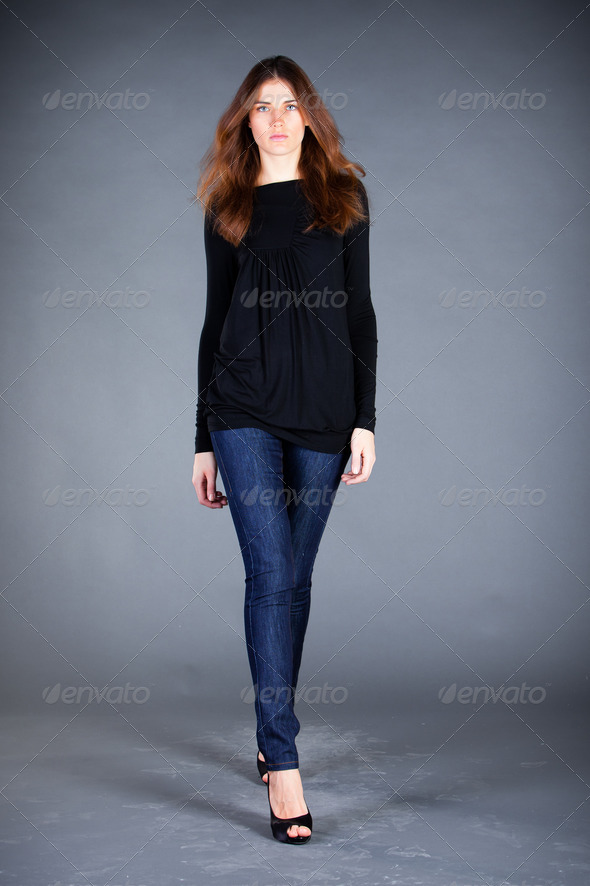 beautiful girl on a dark background - Stock Photo - Images