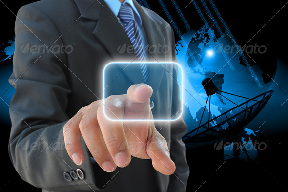 businessman hand pushing button and satellite dish antennas - Stock Photo - Images