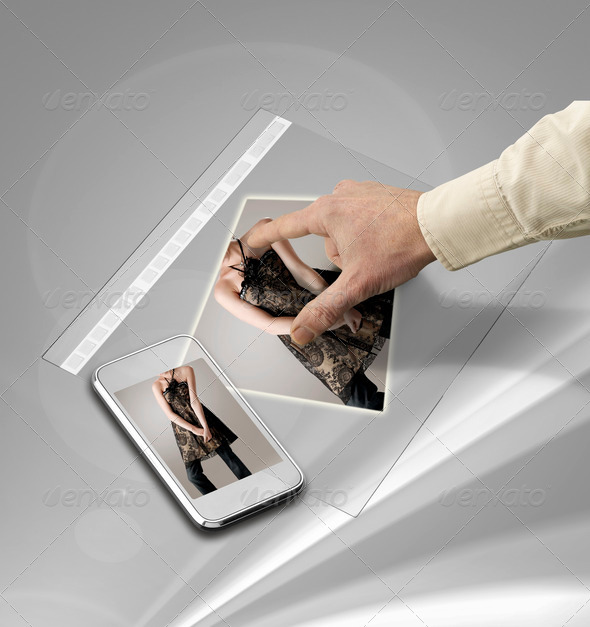 closeup of hand touching screen on futuristic tablet - Stock Photo - Images