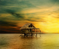 House on wooden stilts in the middle of the ocean - PhotoDune Item for Sale