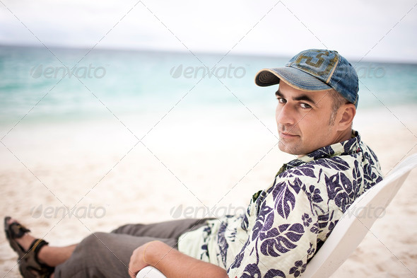 Man at the beach - Stock Photo - Images