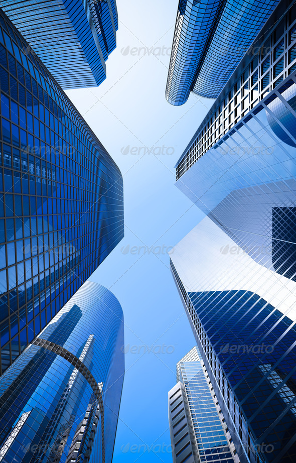 blue highrise glass skyscraper street low angle shot - Stock Photo - Images