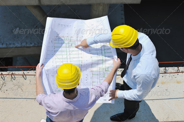Team of architects on construciton site - Stock Photo - Images