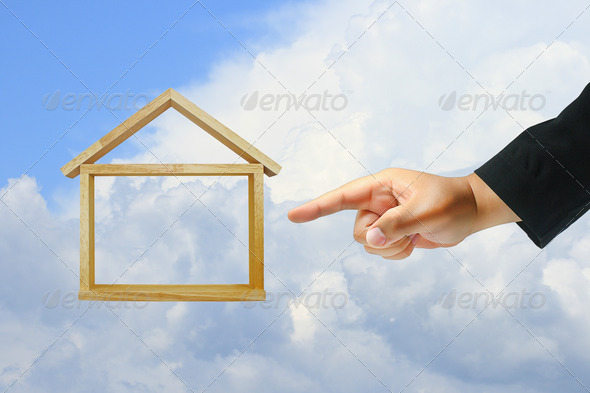 Business hand push home model - Stock Photo - Images