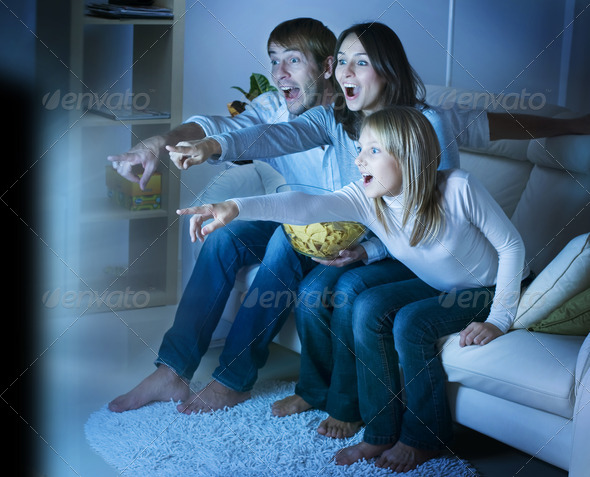 PhotoDune Family watching TV True Emotions 1819200