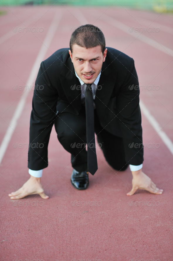 business man in suit at race track - Stock Photo - Images