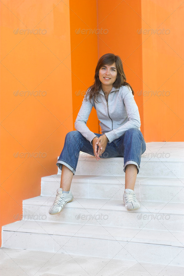 Woman in orange - Stock Photo - Images