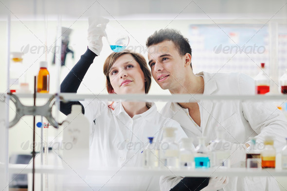 students couple in lab - Stock Photo - Images