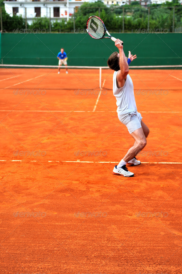 Man plays tennis outdoors - Stock Photo - Images