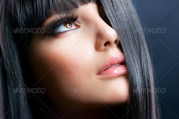 Fashion Brunette . Beautiful Makeup and Healthy Black Hair - Stock Photo - Images