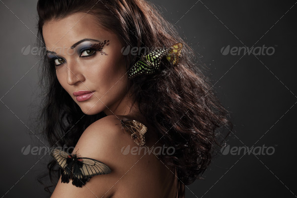 woman and butterfly - Stock Photo - Images
