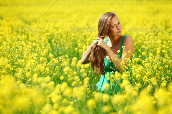 woman on oilseed field - Stock Photo - Images