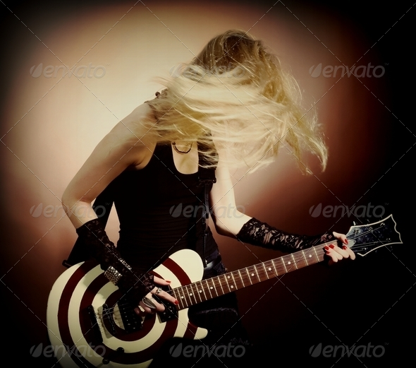 Stock Photo - PhotoDune Woman with guitar 1923227