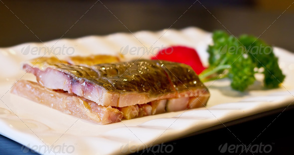 Typical Chinese food of smoke fish slices in white dish - Stock Photo - Images