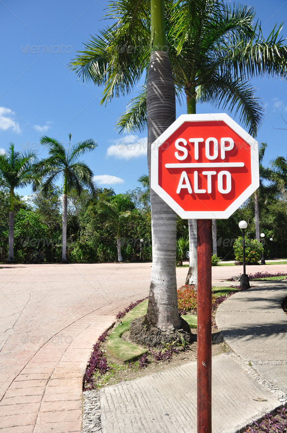 Stop Sign in Spanish and English - Stock Photo - Images