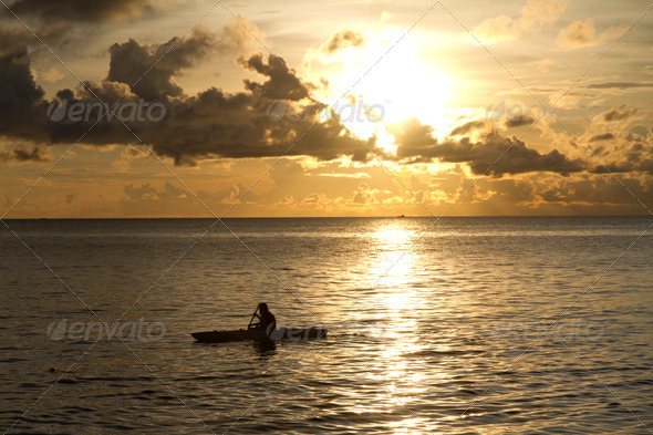 Sunset at South China Sea with canoe in Phu Quoc close to Duong Dong, Vietnam - Stock Photo - Images