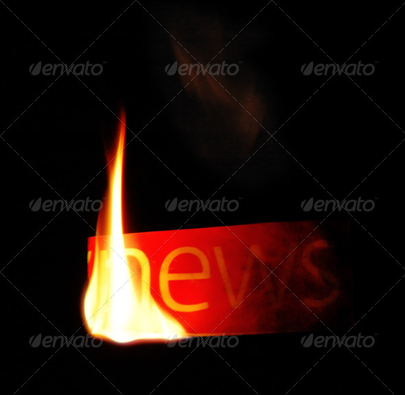 Hot news. Newspaper fire text. - Stock Photo - Images