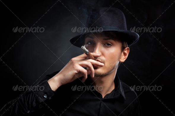 Gangster look. Man with hat and cigar. - Stock Photo - Images
