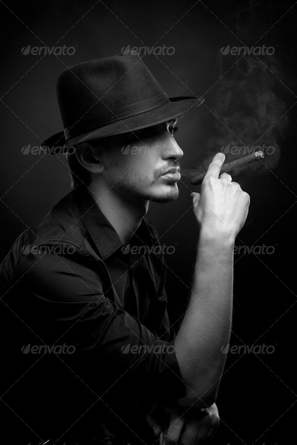 Man with hat and cigar in Black & White - Stock Photo - Images