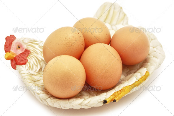 Easter Eggs on hen decorative nest - Stock Photo - Images