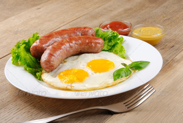 Fried eggs with sausages - Stock Photo - Images