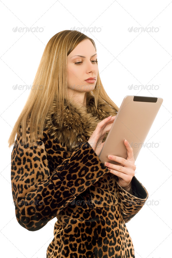 Blonde looking at the tablet pc - Stock Photo - Images