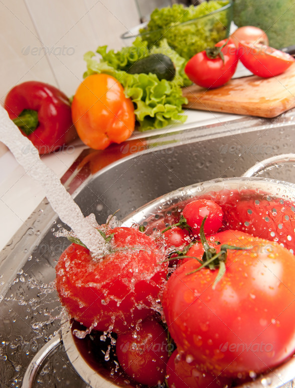 Splashing tomatoes - Stock Photo - Images