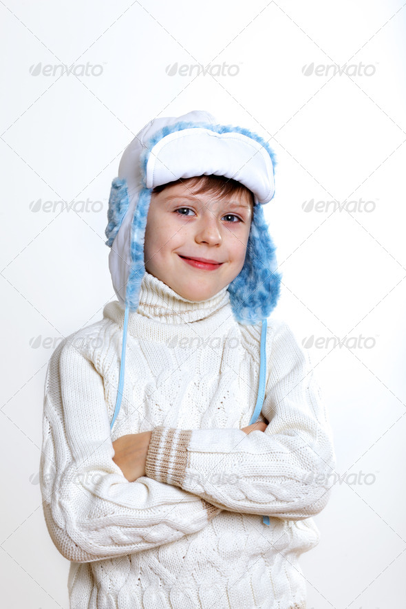 Kid in winter wear against white background - Stock Photo - Images