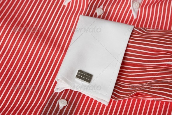 cuff link on men's red shirt - Stock Photo - Images