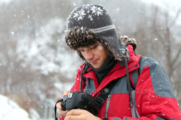 Tourist with camera outdoor - Stock Photo - Images