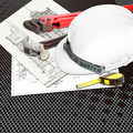 White Helmet of inspectors or engineer constructor with blueprints building construction and tools - PhotoDune Item for Sale