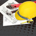 Yellow Helmet of labor constructor with blueprints building construction and tools - PhotoDune Item for Sale