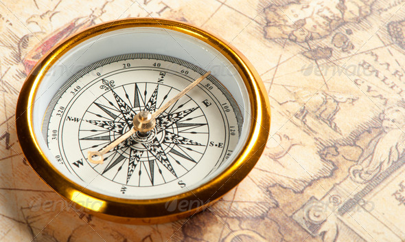 Old compass on ancient map - Stock Photo - Images