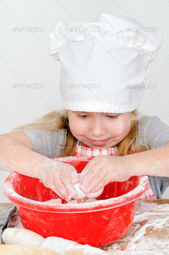 girl in chef's hat - Stock Photo - Images