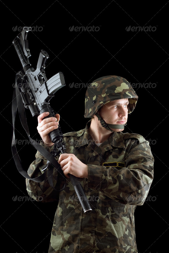 Soldier threatening with a rifle - Stock Photo - Images