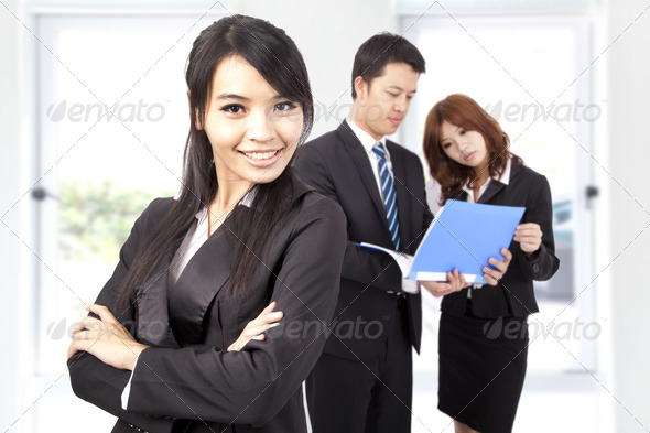 Young and smiling Business woman in an office - Stock Photo - Images
