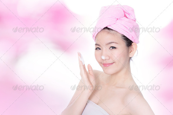 woman washing face with foam on hands - Stock Photo - Images