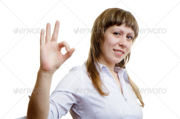 Young girl shows sign ok - Stock Photo - Images