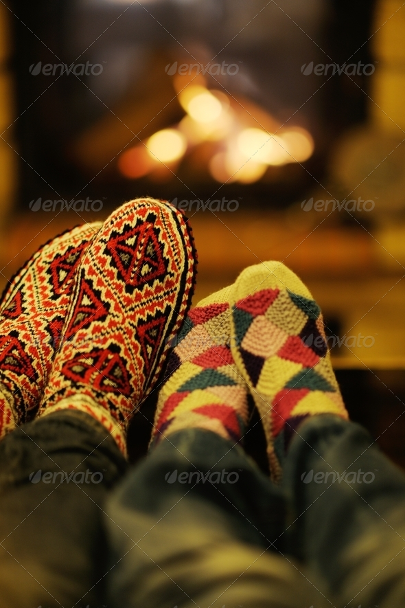 Young romantic couple relax on sofa in front of fireplace at hom - Stock Photo - Images