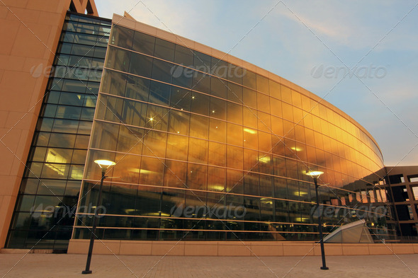 Curved Glass Building Sunset - Stock Photo - Images