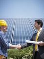 businessman and electrician shaking hands - PhotoDune Item for Sale
