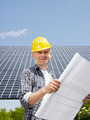 electrician standing near solar panels - PhotoDune Item for Sale