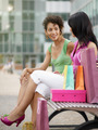 friends sitting on bench with shopping bags - PhotoDune Item for Sale